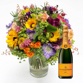 Colorful seasonal bouquet with champagne